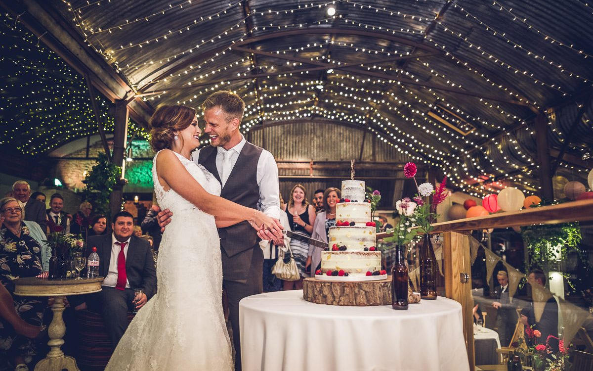 Cripps Stone Barn cutting wedding cake