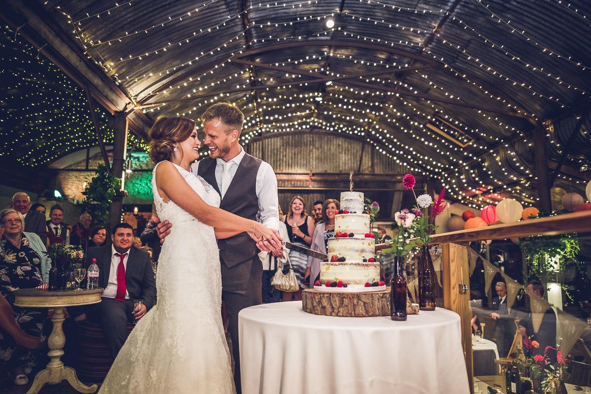 Cripps Stone Barn cutting wedding cake