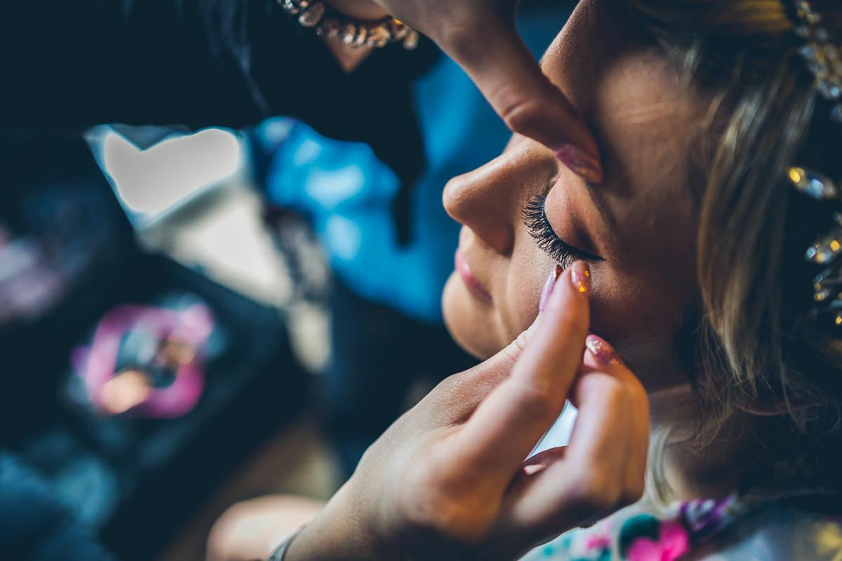 Bride having eyelashes applied