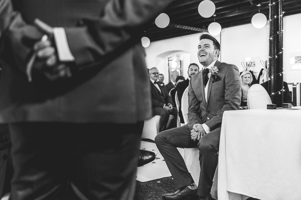 Groom laughing before wedding