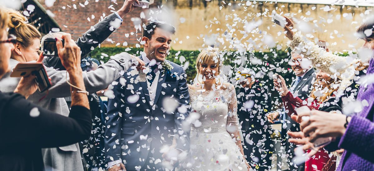 Bride and groom in a cloud of confetti