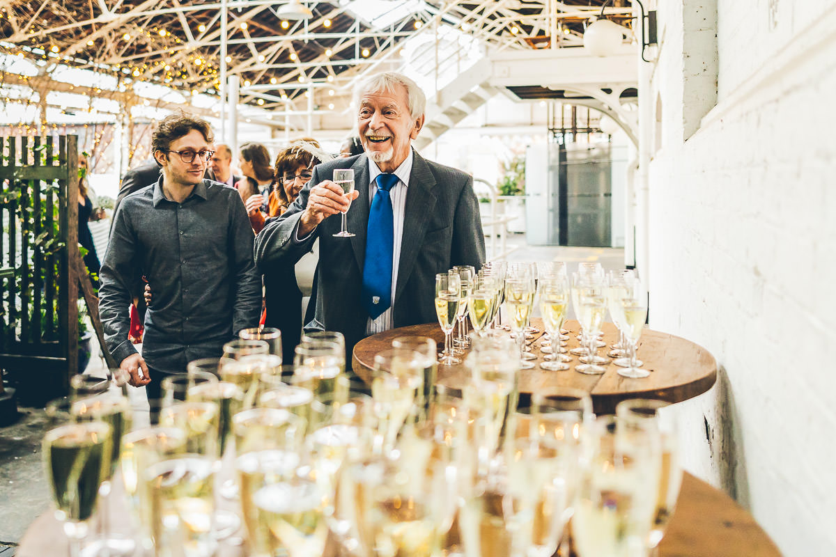 Grandad drinking champagne at a wedding