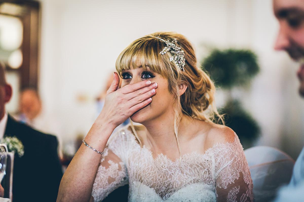 Bride looking horrified at best man's speech
