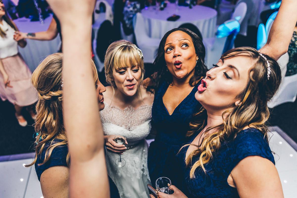 Bride and bridesmaids dancing at a wedding